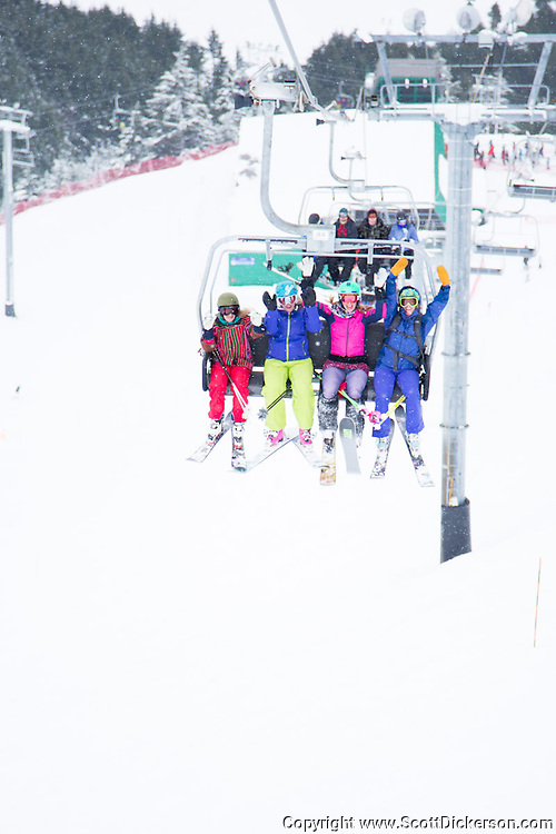 Female skiers enjoying a day of skiing at Alyeska Resort in Girdwood, Alaska as part of the  Get the Girls Out campaign organized by SheJumps.