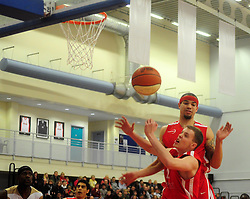 Players react to a rebound  - Photo mandatory by-line: Dougie Allward/JMP - Tel: Mobile: 07966 386802 23/03/2013 - SPORT - Basketball - WISE Basketball Arena - SGS College - Bristol -  Bristol Academy Flyers V Essex Leopards