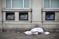 © Licensed to London News Pictures . 06/04/2017 . Manchester , UK . A duvet left on the pavement by cash machines adjacent to bus stops in Piccadilly Gardens . An epidemic of abuse of the drug spice by some of Manchester's homeless population , in plain sight , is causing users to experience psychosis and a zombie-like state and is daily being witnessed in the Piccadilly Gardens area of Manchester , drawing large resource from paramedic services in the city centre . Photo credit : Joel Goodman/LNP