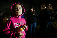 Hana Kim, 6, holds a lit candle during a candlelight vigil in remembrance and support of 'Comfort Women', Japanese military sexual slavery victims during World War II, at Glendale Peace Monument on January 5, 2016 in Glendale, California. AFP PHOTO / Ringo Chiu