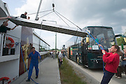 Passengers coming back from the land excursion to Wu?rzburg and Rothenburg ob der Tauber aboard the Club 50's green luxury buses...M.S. Johann Strauss, a brand new four star+ river cruiser operated by Austrian River Cruises, and chartered by Club 50 (a travel agency especially for seniors aged 50 and up) undertook an epic 3-week journey (May 21 to June 10, 2004) all the way from Amsterdam to the Black Sea?along Rhine, Main and Danube?, presumably the first passenger vessel ever to have done so. This is one of the images recorded during this historic voyage.