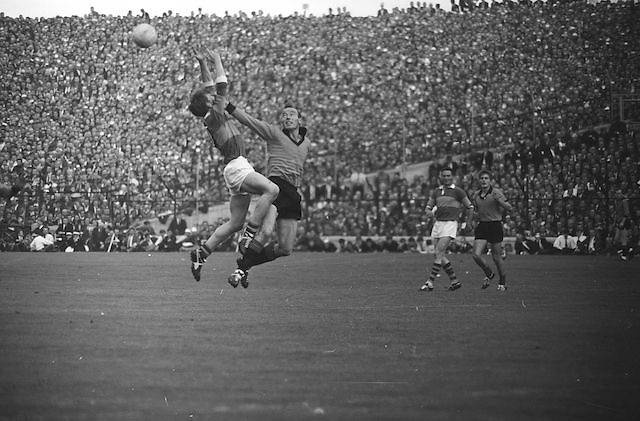 Down defender punches the ball over the head of Kerry forward during the All Ireland Senior Gaelic Football Final Kerry v Down in Croke Park on the 22nd September 1968. Down 2-12 Kerry 1-13.