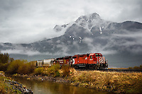 This CP Rail engine was sitting on the tracks just to the east of Exshaw. The cloud cover on the mountain behind provided a very cool contrast to the warmth of the dead grasses and water in the foreground...<br /> <br /> &copy;2013, Sean Phillips<br /> http://www.RiverwoodPhotography.com