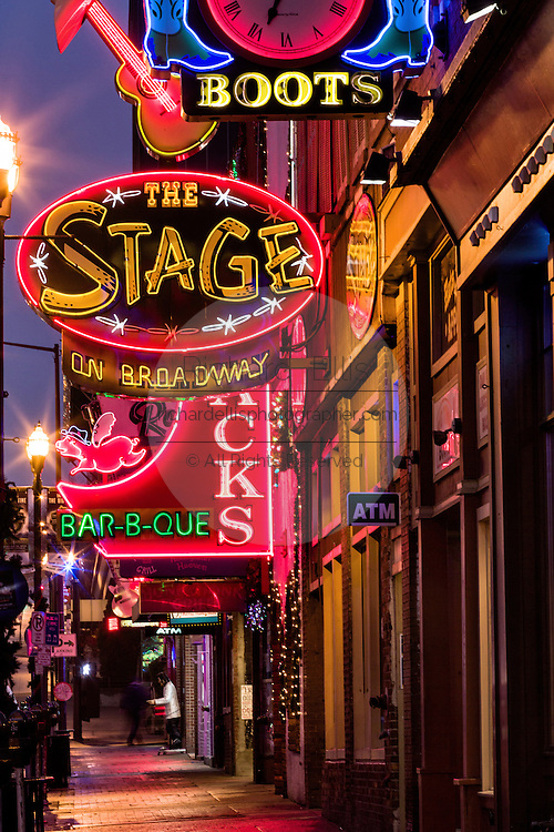 Signs for The Stage, Jacks Bar-B-Que and other honky-tonks on lower Broadway in Nashville, TN.