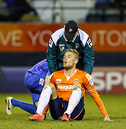 Jayden Stockley of Luton Town, currently on loan from AFC Bournemouth,  receives treatment on the pitch for an injury during the Sky Bet League 2 match at Kenilworth Road, Luton<br /> Picture by David Horn/Focus Images Ltd +44 7545 970036<br /> 08/01/2015