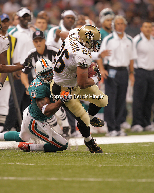 2008 August 28: Deuce McAllister (26) of the New Orleans Saints tries to break the tackle of Yeremiah Bell (37) of the Miami Dolphins at the Louisiana Superdome in New Orleans, LA.