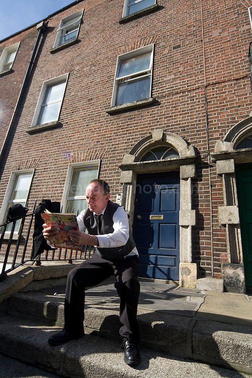 "Editorial Use Only. Bloomsday June  16th 2008, Dublin. Actor Paul O'Hanrahan from Balloonatics theatre company performs the ""Calypso"" chapter from  James Joyce novel Ulysses around Eccles St. and Dorset Street. ..In this photo, Bloom is reading while sitting on the ""jakes"" or toilet."