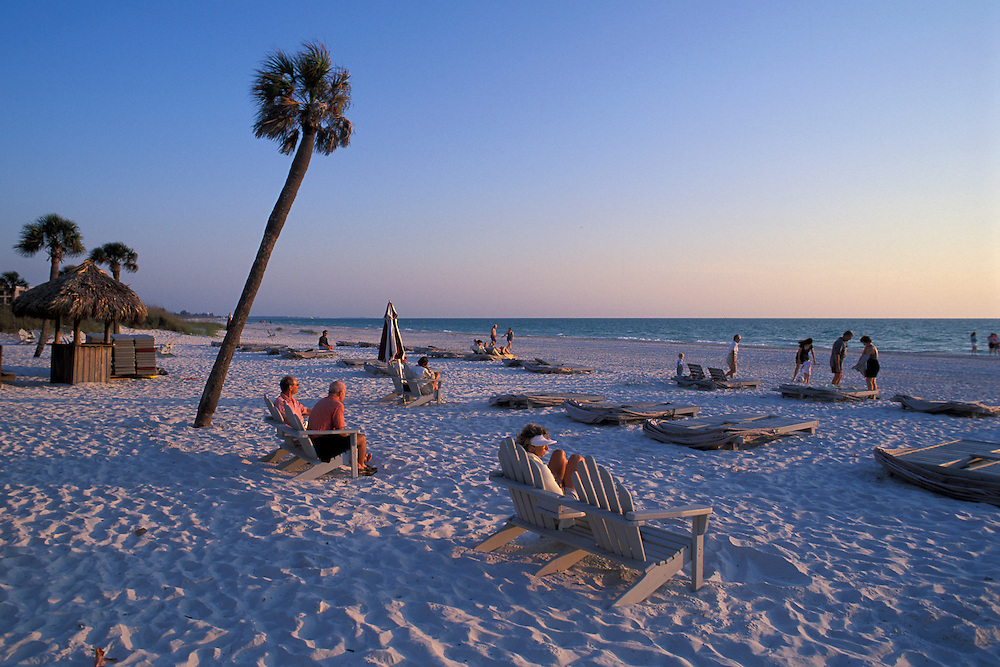 adirondack chairs on beach sunset. Delighful Chairs People Watching The Sunset Adirondack Chairs At Sand Beach StPetersburg  Beach Throughout Chairs On Beach Sunset