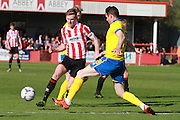 Kyle Storer and Lee Beavers during the Vanarama National League match between Cheltenham Town and Lincoln City at Whaddon Road, Cheltenham, England on 30 April 2016. Photo by Antony Thompson.