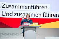 07 DEC 2018, HAMBURG/GERMANY:<br /> Angela Merkel, CDU, Bundeskanzlerin, haelt Ihre letzte Rede als Parteivorsitzende, im Hintergrund Standing ovations der Delegierten auf dem Screen, CDU Bundesparteitag, Messe Hamburg<br /> IMAGE: 20181207-01-017<br /> KEYWORDS: party congress, speech