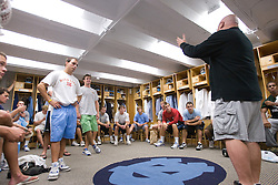 14 September 2007: North Carolina Tar Heels men's lacrosse members listen to lacrosse sports information director Dave Lohse explain the concept for the team photo to be taken the next week in Chapel Hill, NC.