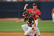 Mississippi's Alex Yarbrough (2) forces out Tennessee's Blake Forsythe (11) and throws to first for a double play in a college baseball at Oxford-University Stadium on Friday, April 2, 2010 in Oxford, Miss. Ole Miss won 7-3.