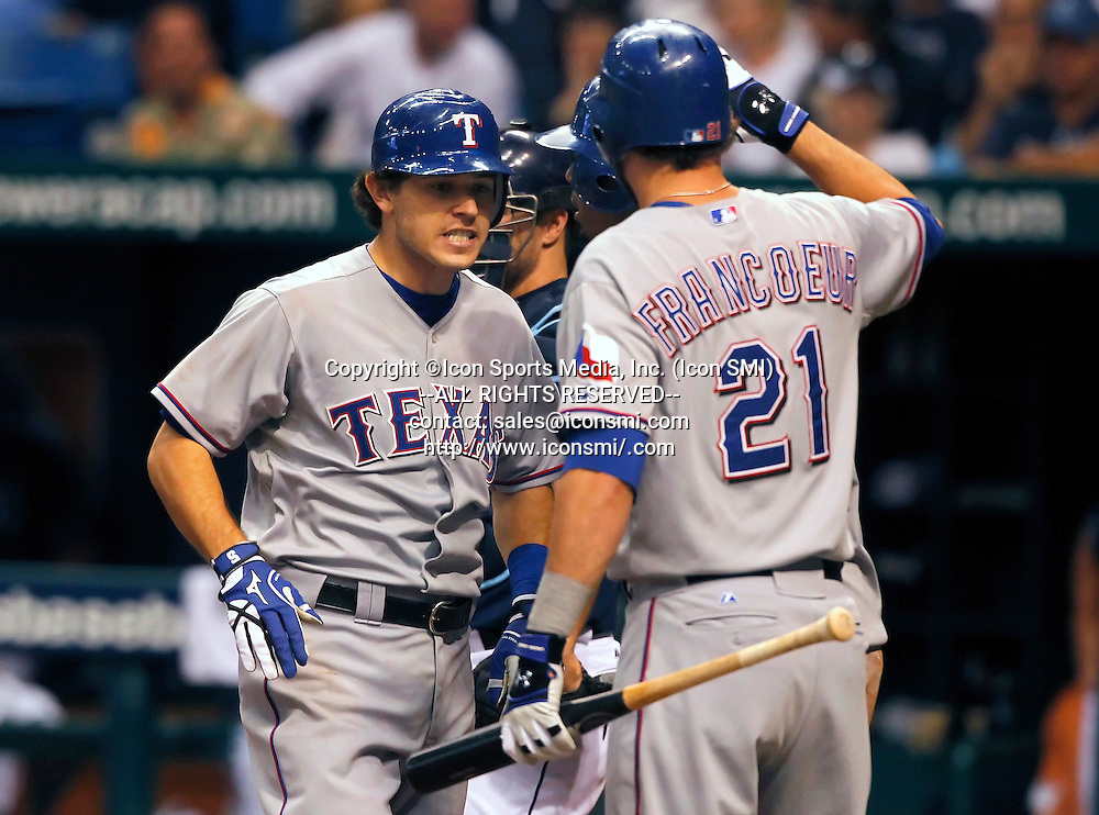 12 OCT 2010:  Ian Kinsler of the Rangers is congratulated on his ninth inning home run by Jeff Francoeur after touching home plate during the American League Division Series game #5 between the Texas Rangers and the Tampa Bay Rays at Tropicana Field in St. Petersburg, Florida.  Rangers win the series 3 games to 2 behind the strong pitching performance of Cliff Lee in Games 1 and 5.