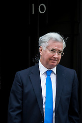 © Licensed to London News Pictures. 23/02/2016. London, UK. Defence Secretary MICHAEL FALLON leaves number 10 Downing Street in Westminster, London after cabinet meeting. Photo credit: Ben Cawthra/LNP