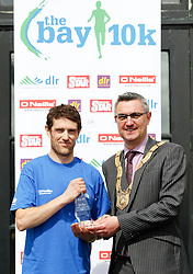 No fee for Repro:.Eoin Brennan second place at the DLR Bay 10K road race in a time of 33.29 minutes pictured been presented with his winning prize by An Cathaoirleach Cllr Tom Joyce, Dun Laoghaire-Rathdown County Council. Pic Jason Clarke Photography