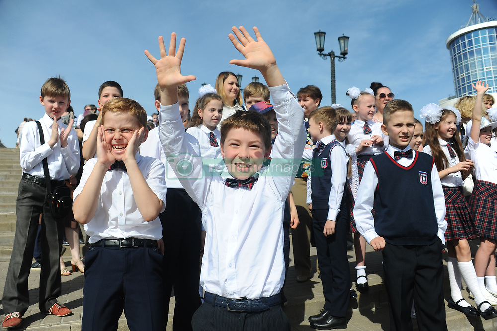 May 23, 2019 - Tambov, Tambov region, Russia - On may 22, the last school bell rang for future high school graduates in many Russian schools. Now they will take final exams and enroll in various schools, and for the rest of the students will soon come the summer holidays. In the city of Tambov (Russia) solemn school line (last bell) was held on the music Square. In the photo - elementary school students are happy about the upcoming summer vacation at the solemn line (the last school bell) on the Music Square  (Credit Image: © Demian Stringer/ZUMA Wire)