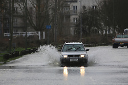© Licensed to London News Pictures. 01/08/2014. A car in the closed road at Chertsey Bridge. Recent bad weather has caused the river Thames in south west London and Surrey to reach very high levels. Credit : Rob Powell/LNP
