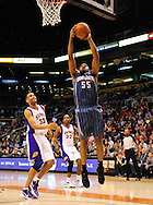 Feb. 4, 2012; Phoenix, AZ, USA; Charlotte Bobcats forward Reggie Williams (55) dunks the ball against the Phoenix Suns forward Grant Hill (33) during the first half at the US Airways Center. Mandatory Credit: Jennifer Stewart-US PRESSWIRE.