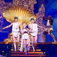 """Australian pop singer Kylie Minogue (C) performs on stage during her """"Aphrodite - Les Folies""""-Tour at Hallenstadion in Zurich, Switzerland, Wednesday, March 9, 2011. (Photo by Patrick B. Kraemer / MAGICPBK)"""
