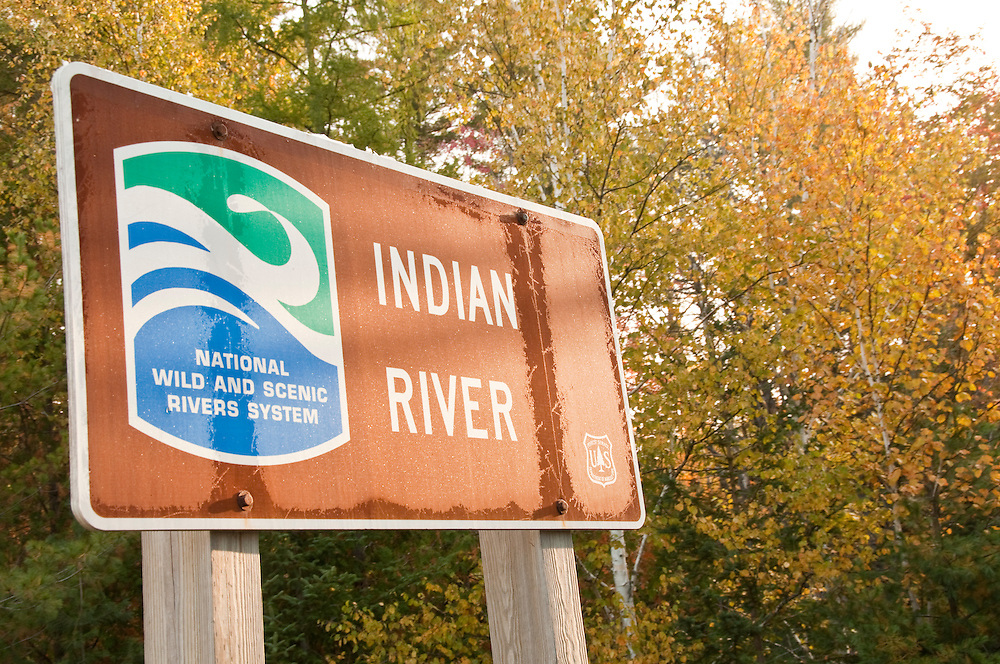 Sign for the Indian River flowing through the Hiawatha National Forest near Munising Michigan in autumn.