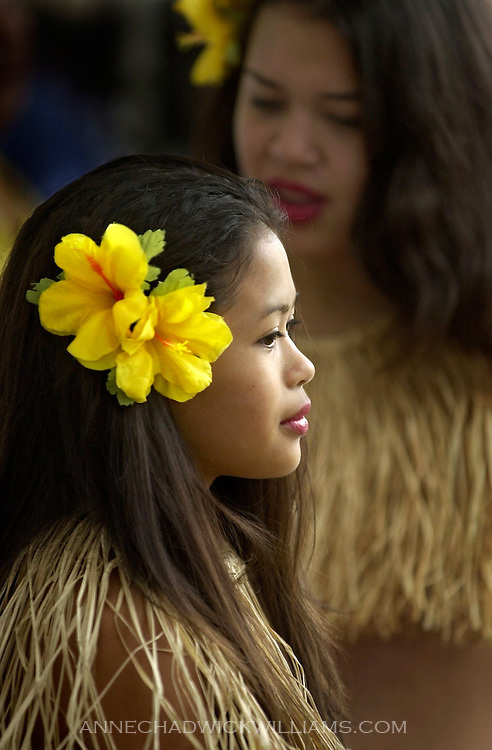 Jackie Marqueta, 13, and Christina Teczon, 13, background, wait to perform a Pacific Islander traditional dance during the Pacific Rim Festival in Sacramento, CA on May 19, 2002.