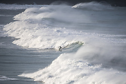 November 18, 2018 - Newquay, Cornwall, England - A surfer braves Newquay's famous Cribbar waves off Towan Headland, created by wind conditions, the swell and the tide all combining. The waves, which can be over 30ft tall, are popular with experienced big wave surfers from across the world. (Credit Image: © Mark Hemsworth/London News Pictures via ZUMA Wire)