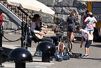 Dave the One Man Band plays on the Inner Harbour Walkway in Victoria, BC in his spot as a regular busker and entertainer.