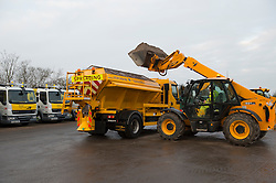 © Licensed to London News Pictures. 19/11/2013. Chelmsford, UK.  FILE PICTURE taken 11th Jan 2013. As the UK braces for two weeks of cold weather coucils are begining their road gritting. Pictured is Essex Highways depot at Springfield, Chelmsford. A gritter lorry is loaded, ready to keep the roads of Essex clear. Photo credit : Simon Ford/LNP