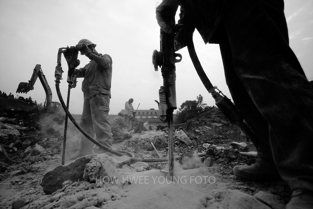 Workers working at the construction site of the Taocha canal head works, the 'tap' of the channel transferring water from Danjiangkou reservoir to Beijing, part of the central route of the South-to-North Water Transfer project in Xichuan county of Henan Province in China on 27 June 2010. The South-to-North Water Transfer project, the largest known water diversion project, was conceived in 1952 to solve the country's chronic water shortages and involves creating three routes to channel 44.8 billion cu m of water from southern China to the northern areas. As part of the project's central route, affecting Henan and Hubei provinces, water from the Danjiangkou reservoir will be diverted to Beijing.