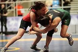 London, Ontario ---2013-03-02---   Natalie Brady of The University Of Alberta takes on Cara Nania of The University Of Calgary in the women's 51 KG bronze medal match at the 2012 CIS Wrestling Championships in London, Ontario, March 02, 2013. .GEOFF ROBINS/Mundo Sport Images