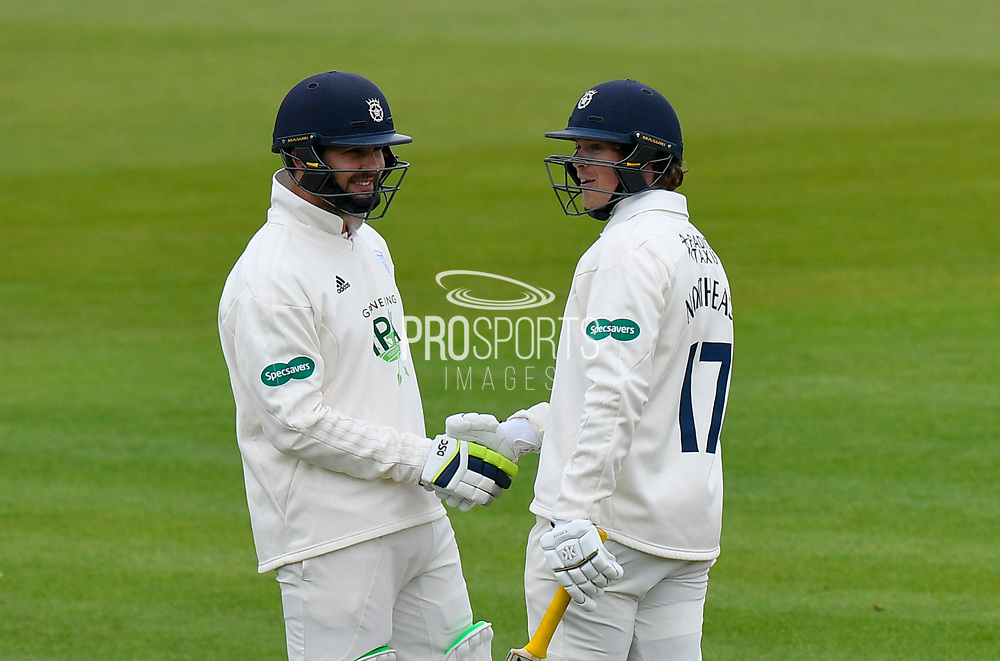 50 for Sam Northeast of Hampshire - Sam Northeast of Hampshire celebrates scoring a half century and is congratulated by Rilee Rossouw of Hampshire during the first day of the Specsavers County Champ Div 1 match between Hampshire County Cricket Club and Essex County Cricket Club at the Ageas Bowl, Southampton, United Kingdom on 5 April 2019.