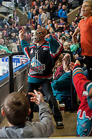 KELOWNA, CANADA - OCTOBER 25: A Kelowna Rockets fan dances with a halloween mask on in the stands as the Kelowna Rockets take on the Brandon Wheat Kings on October 25, 2014 at Prospera Place in Kelowna, British Columbia, Canada.  (Photo by Marissa Baecker/Shoot the Breeze)  *** Local Caption *** Fan;