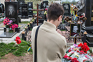 KHARKIV, UKRAINE - APRIL 22: Nikolai Prohorenko visits the grave of Vladislav Zubenko, who died after being shot during the Euromaidan protests in Kiev in February, on what would have been his 23rd birthday on April 22, 2014 in Kharkiv, Ukraine. Following turbulence with the central government, pro-Russian activists have been occupying government buildings and demanding greater autonomy in many Eastern Ukrainian cities in recent weeks. (Photo by Brendan Hoffman/Getty Images) *** Local Caption *** Nikolai Prohorenko