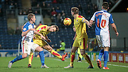 Joe Mattock (Rotherham United) bends low to head the ball out ahead of the Blackburn attacker during the Sky Bet Championship match between Blackburn Rovers and Rotherham United at Ewood Park, Blackburn, England on 11 December 2015. Photo by Mark P Doherty.