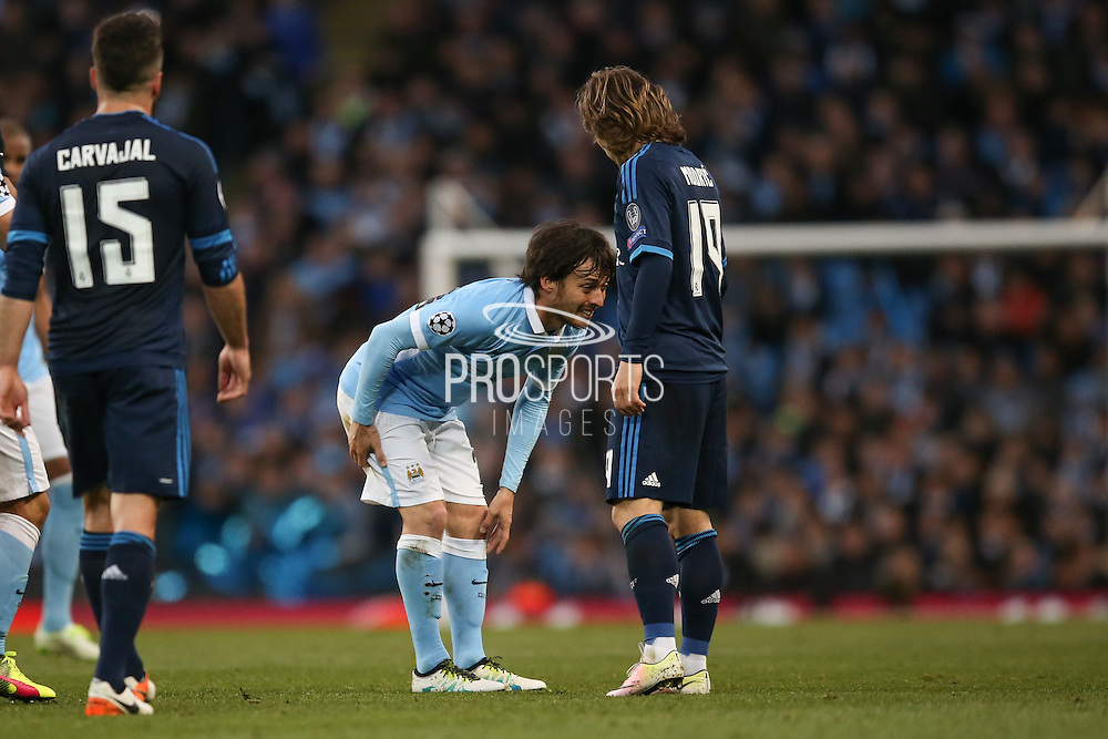 Manchester City midfielder David Silva (21) feels his injury and he has to leave the pitch injured during the Champions League match between Manchester City and Real Madrid at the Etihad Stadium, Manchester, England on 26 April 2016. Photo by Simon Davies.