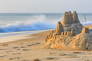 The high tide close ing in on this sand castle in Duck, NC.