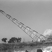 demoliton in 1995 of one of three US Navy, 1917 era antenna array towers.
