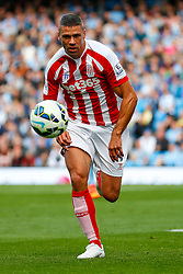 Jonathan Walters of Stoke in action - Photo mandatory by-line: Rogan Thomson/JMP - 07966 386802 - 30/08/2014 - SPORT - FOOTBALL - Manchester, England - Etihad Stadium - Manchester City v Stoke City - Barclays Premier League.
