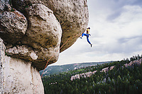 Roping clouds. Sam Elias digs deep for the redpoint of Cowboy King, 5.13c, Wild Iris, Wyoming.
