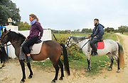 Young man and woman horse riding in countryside near Ronda, Malaga province, Sp