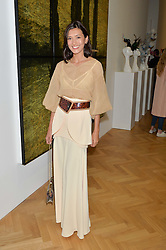 HIKARI YOKOYAMA at a private view and auction of millinery organised by author, philanthropist and hat collector Eva Lanska in aid of Women for Women International held at Pace, Burlington Gardens, London on 10th June 2015.