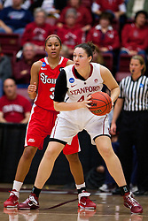 March 21, 2011; Stanford, CA, USA; Stanford Cardinal forward/center Sarah Boothe (42) is defended by St. John's Red Storm forward Da'Shena Stevens (3) during the first half of the second round of the 2011 NCAA women's basketball tournament at Maples Pavilion. Stanford defeated St. John's 75-49.