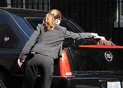 © licensed to London News Pictures. LONDON, UK  25/05/11. A chauffeur polishes the President's car. Barak Obama and David Cameron meet in Downing Street during US President Obama's first State Visit to the United Kingdom. Please see special instructions. Photo credit should read Stephen Simpson/LNP