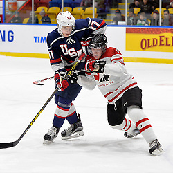 WHITBY, - Dec 18, 2015 -  Game #12 - Bronze Medal Game, Team Canada East vs. United States at the 2015 World Junior A Challenge at the Iroquois Park Recreation Complex, ON.  Collin Peters #17 of Team United States battles for position with Derek Topatigh #6 of Team Canada East during the first period.<br /> (Photo: Shawn Muir / OJHL Images)
