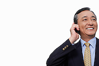 Happy businessman using cell phone over white background