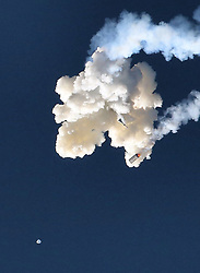 At the moment of the abort manuever, the Orion test capsule can be seen falling from the separation cloud, with the rescue tower and Minotaur 4 booster falling (above), during the Ascent Abort-2 mission at Cape Canaveral Air Force Station, FL, USA, on Tuesday, July 2, 2019. Photo by Joe Burbank/Orlando Sentinel/TNS/ABACAPRESS.COM