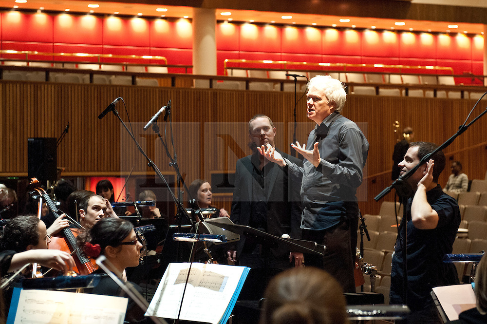 © Licensed to London News Pictures. 03/03/2012. London, UK. From the technical rehearsal for the London premier on March 3rd 2012  of Surrogate Cities by Heiner Goebbels. Featuring Trinity Laban Symphony Orchestra and performed at the Royal Festival Hall, London. Picture shows the composer working with the students. Photo credit : Tony Nandi/LNP