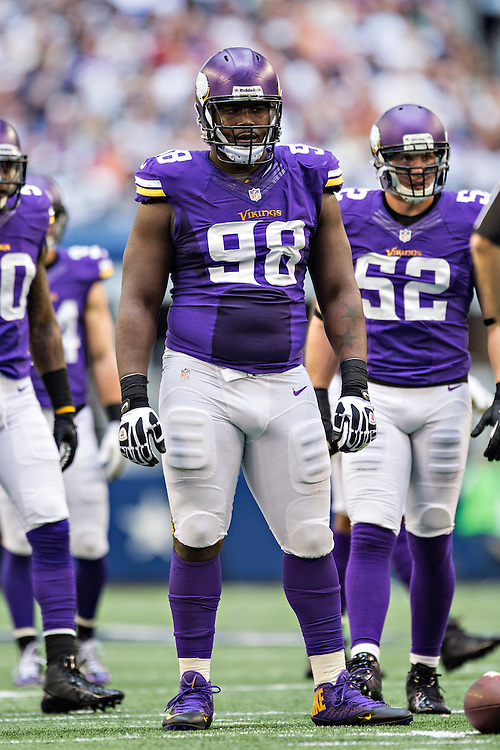 ARLINGTON, TX - NOVEMBER 3:  Letroy Guion #98 of the Minnesota Vikings at the line of scrimmage during a game against the Dallas Cowboys at  AT&T Stadium on November 3, 2013 in Arlington, Texas.  The Cowboys defeated the Vikings 27-23.  (Photo by Wesley Hitt/Getty Images) *** Local Caption *** Letroy Guion