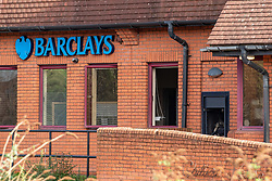 © Licensed to London News Pictures. 25/02/2020. Gerrards Cross, UK. A damaged ATM and window after a Barclays Bank next to Gerrards Cross train station was targeted in an overnight robbery. Photo Credit: Peter Manning/LNP