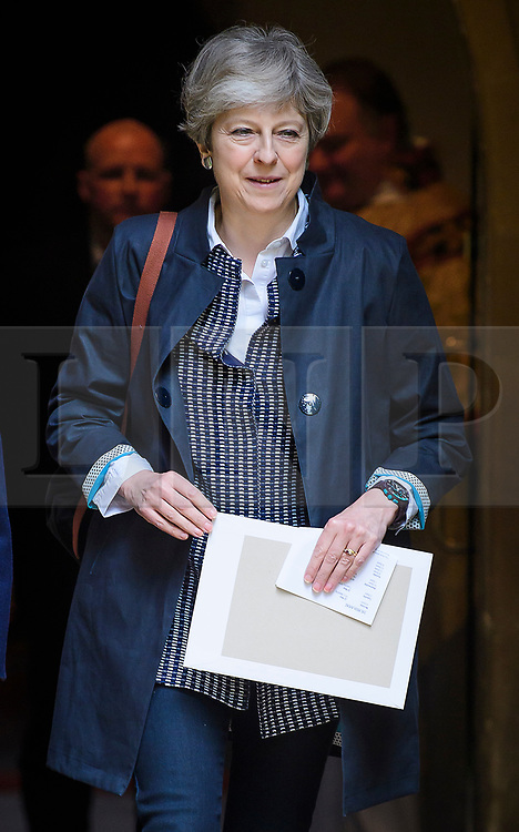 © Licensed to London News Pictures. 21/05/2017. Maidenhead, UK.  British Prime Minister THERESA MAY attends church in her Maidenhead constituency with her husband PHILIP.  Polls over the weekend have shown a closing in the gap between the the Conservatives and Labour, ahead of a general election on June 8, 2017. Photo credit: Ben Cawthra/LNP